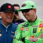 DOVER, DELAWARE - OCTOBER 06: Kyle Busch, driver of the #18 Interstate Batteries Toyota, talks with team owner, Joe Gibbs, prior to the start of the Monster Energy NASCAR Cup Series Drydene 400 at Dover International Speedway on October 06, 2019 in Dover, Delaware. (Photo by Jeff Zelevansky/Getty Images)