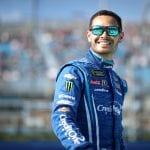 HOMESTEAD, FLORIDA - NOVEMBER 17: Kyle Larson, driver of the #42 Credit One Bank Chevrolet, stands on the grid  during the Monster Energy NASCAR Cup Series Ford EcoBoost 400 at Homestead Speedway on November 17, 2019 in Homestead, Florida. (Photo by Chris Graythen/Getty Images) | Getty Images