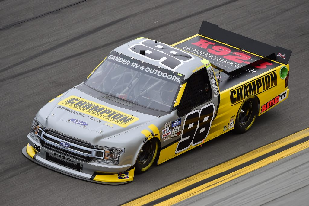 DAYTONA BEACH, FLORIDA - FEBRUARY 14: Grant Enfinger, driver of the #98 Champion/Curb Records Ford, qualifies for the NASCAR Gander RV & Outdoors Truck Series NextEra Energy 250 at Daytona International Speedway on February 14, 2020 in Daytona Beach, Florida. (Photo by Jared C. Tilton/Getty Images) | Getty Images