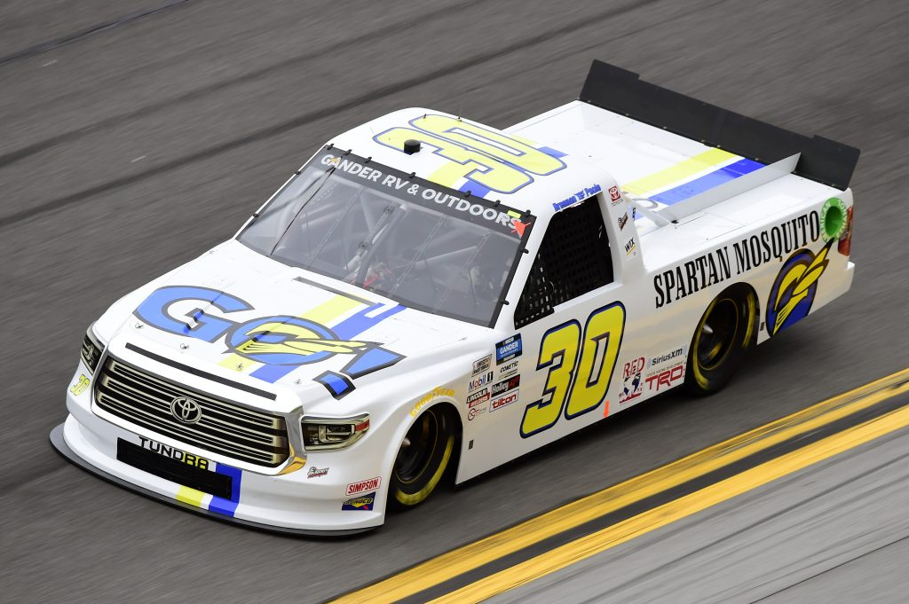 DAYTONA BEACH, FLORIDA - FEBRUARY 14: Brennan Poole, driver of the #30 Spartan Mosquito Toyota, qualifies for the NASCAR Gander RV & Outdoors Truck Series NextEra Energy 250 at Daytona International Speedway on February 14, 2020 in Daytona Beach, Florida. (Photo by Jared C. Tilton/Getty Images) | Getty Images