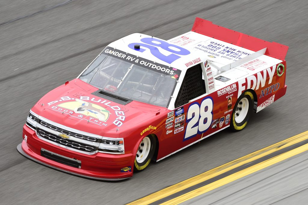 DAYTONA BEACH, FLORIDA - FEBRUARY 14: Bryan Dauzat, driver of the #28 FDNY/AMERICAN GENOMICS Chevrolet, qualifies for the NASCAR Gander RV & Outdoors Truck Series NextEra Energy 250 at Daytona International Speedway on February 14, 2020 in Daytona Beach, Florida. (Photo by Jared C. Tilton/Getty Images) | Getty Images