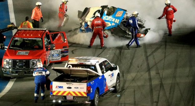 DAYTONA BEACH, FLORIDA - FEBRUARY 17:  Track workers attend to Ryan Newman, driver of the #6 Koch Industries Ford, following a crash during the NASCAR Cup Series 62nd Annual Daytona 500 at Daytona International Speedway on February 17, 2020 in Daytona Beach, Florida. (Photo by Mike Ehrmann/Getty Images) | Getty Images