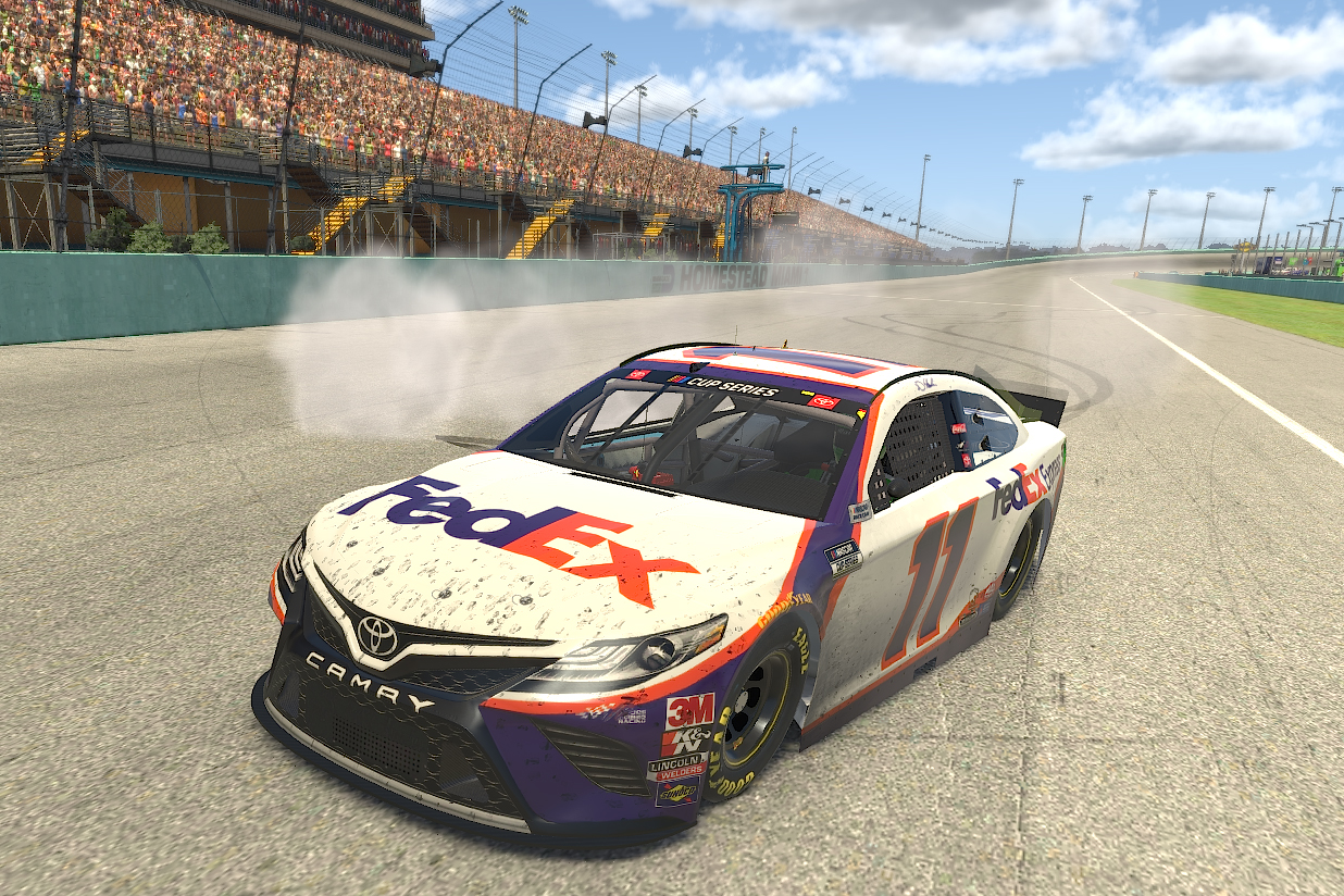HOMESTEAD, FLORIDA - MARCH 22: (EDITORIAL USE ONLY) (Editors note: This image was computer generated in-game) Denny Hamlin, driver of the #11 FedEx Toyota, celebrates after winning the eNASCAR iRacing Pro Invitational Series Dixie Vodka 150 at virtual Homestead-Miami Speedway on March 22, 2020 in Homestead, Florida. (Photo by Chris Graythen/Getty Images) | Getty Images
