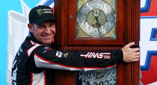 MARTINSVILLE, VA - MARCH 26:  Clint Bowyer, driver of the #14 Haas Automation Demo Day Ford, celebrates with the trophy in Victory Lane after winning the weather delayed Monster Energy NASCAR Cup Series STP 500 at Martinsville Speedway on March 26, 2018 in Martinsville, Virginia.  (Photo by Sarah Crabill/Getty Images) | Getty Images