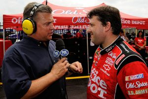 CONCORD, NC – MAY 25: Fox personality Steve Byrnes (L) speaks with Tony Stewart, driver of the #14 Office Depot/Old Spice Chevrolet during a red flag due to rain for the NASCAR Sprint Cup Series Coca-Cola 600 on May 25, 2009 at Lowe's Motor Speedway in Concord, North Carolina. (Photo by Rusty Jarrett/Getty Images for NASCAR) | Getty Images
