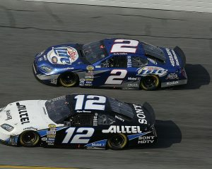 DAYTONA BEACH, FL – February 20, 2005: Roger Penske Racing teammates Ryan Newman (No. 12) and Rusty Wallace (No. 2) race their Dodges side by side during the running of the Daytona 500 NASCAR Cup race at Daytona International Speedway. Wallace went on to finish tenth while Newman was 20th. (Photo by ISC Images & Archives via Getty Images)
