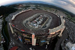 BRISTOL, TN – AUGUST 25: Cars race during the NASCAR Sprint Cup Series IRWIN Tools Night Race at Bristol Motor Speedway on August 25, 2012 in Bristol, Tennessee. (Photo by Andrew Coppley – Pool/Getty Images for NASCAR) | Getty Images