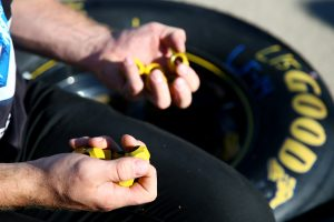 JOLIET, IL – SEPTEMBER 18: Detail view of lugnuts being put on a tire prior the NASCAR Sprint Cup Series Teenage Mutant Ninja Turtles 400 at Chicagoland Speedway on September 18, 2016 in Joliet, Illinois. (Photo by Sarah Crabill/Getty Images) | Getty Images