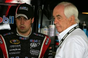 WATKINS GLEN, NY – AUGUST 08: Sam Hornish Jr. (L), driver of the #77 Mobil 1 Dodge, talks with team owner Roger Penske (R) during practice for the NASCAR Sprint Cup Series Heluva Good! Sour Cream Dips at Watkins Glen International on August 8, 2009 in Watkins Glen, New York. (Photo by Todd Warshaw/Getty Images for NASCAR) | Getty Images