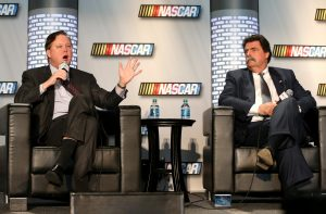 CONCORD, NC – JANUARY 22: (L-R) Brian France, NASCAR Chairman and CEO, and Mike Helton, President of NASCAR, speak to the media about the upcoming season during the 2013 NASCAR Sprint Media Tour at the NASCAR Hall of Fame on January 22, 2013 in Concord, North Carolina. (Photo by Streeter Lecka/Getty Images for NASCAR) | Getty Images