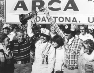 DAYTONA BEACH, FL – FEBRUARY 11, 1979:  Kyle Petty in victory lane with his wife after winning the ARCA race at Daytona, his first-ever win. To Kyle's right are his grandparents, and to his left, his parents.  (Photo by ISC Archives/CQ-Roll Call Group via Getty Images)