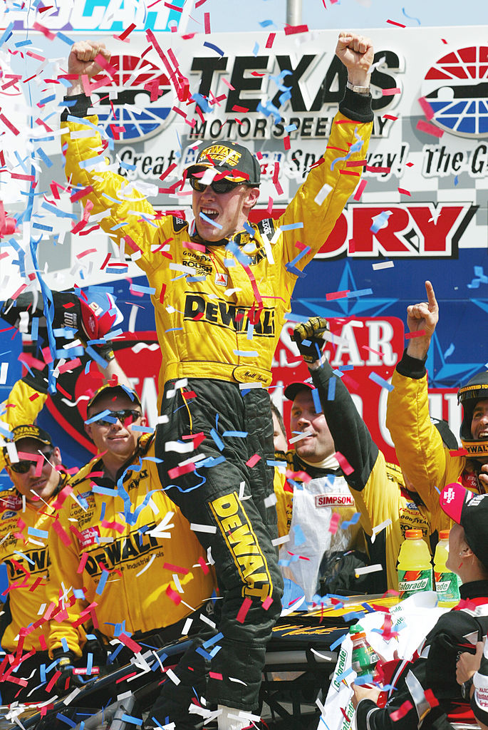 8 APR 2002. Matt Kenseth celebrates in victory circle after winning the Samsung/Radio Shack 500, round 7 of the NASCAR Winston Cup Series at the Texas Motor Speedway in Fort Worth, Texas. Mandatory Credit: Robert Laberge/Getty Images.
