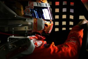 LOUDON, NH - JULY 15: Tony Stewart, driver of the #20 The Home Depot, sits in his car prior to practice for the NASCAR Nextel Cup Series Lenox Industrial Tools 300 on July 15, 2006 at New Hampshire International Speedway in Loudon, New Hampshire. (Photo by Jamie Squire/Getty Images) | Getty Images