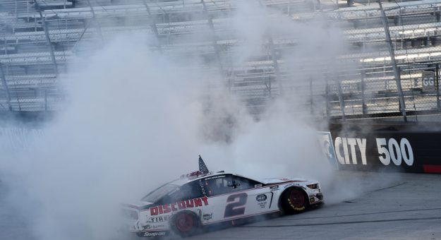 BRISTOL, TENNESSEE - MAY 31: Brad Keselowski, driver of the #2 Discount Tire Ford, celebrates with a burn out after winning  the NASCAR Cup Series Food City presents the Supermarket Heroes 500 at Bristol Motor Speedway on May 31, 2020 in Bristol, Tennessee. (Photo by Jared C. Tilton/Getty Images) | Getty Images
