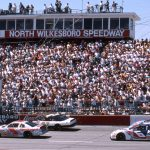 NORTH WILKESBORO, NC - APRIL 14, 1996:  Terry Labonte (No 5) and Elton Sawyer (No 27) bring the field to the start of the First Union 400 at North Wilkesboro Speedway. Mark Martin is in No. 6 and the No. 43 is Bobby Hamilton. (Photo by ISC Images & Archives via Getty Images)