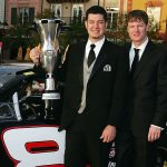 ORLANDO, FL - DECEMBER 10: 2004 NASCAR Busch Series Champion Martin Truex Jr. (L) poses with Dale Earnhardt Jr., co-owner of the Chance 2 Motorsports #8 Bass Pro Shops Chevrolet, and the championship trophy at the 2004 NASCAR Busch Series Awards Ceremony at the Portofino Bay Hotel on December 10, 2004 in Orlando, Florida. (Photo by Scott Halleran/Getty Images for NASCAR) | Getty Images