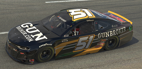 NORTH WILKESBORO, NORTH CAROLINA - MAY 09: (EDITORIAL USE ONLY) (Editors note: This image was computer generated in-game)  Garrett Smithley, driver of the #51 GunBroker.com Chevrolet, races during the eNASCAR iRacing Pro Invitational Series North Wilkesboro 160 at virtual North Wilkesboro Speedway on May 09, 2020 in North Wilkesboro, North Carolina. (Photo by Chris Graythen/Getty Images) | Getty Images