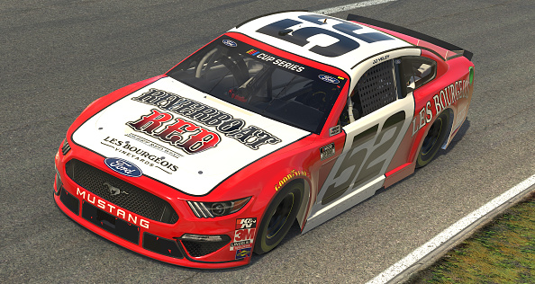 NORTH WILKESBORO, NORTH CAROLINA - MAY 09: (EDITORIAL USE ONLY) (Editors note: This image was computer generated in-game)  JJ Yeley, driver of the #52 Les Bourgeois Vineyards Ford,  races during the eNASCAR iRacing Pro Invitational Series North Wilkesboro 160 at virtual North Wilkesboro Speedway on May 09, 2020 in North Wilkesboro, North Carolina. (Photo by Chris Graythen/Getty Images) | Getty Images
