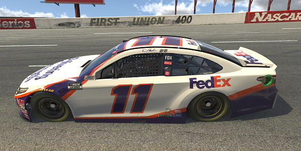 NORTH WILKESBORO, NORTH CAROLINA - MAY 09: (EDITORIAL USE ONLY) (Editors note: This image was computer generated in-game) Denny Hamlin, driver of the #11 FedEx Delivering Strength Toyota, races during the eNASCAR iRacing Pro Invitational Series North Wilkesboro 160 at virtual North Wilkesboro Speedway on May 09, 2020 in North Wilkesboro, North Carolina. (Photo by Chris Graythen/Getty Images) | Getty Images