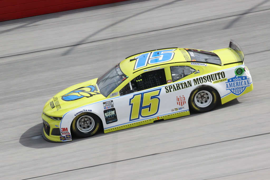 DARLINGTON, SOUTH CAROLINA - MAY 17: Brennan Poole, driver of the #15 SpartanGO Chevrolet, drives during the NASCAR Cup Series The Real Heroes 400 at Darlington Raceway on May 17, 2020 in Darlington, South Carolina. NASCAR resumes the season after the nationwide lockdown due to the ongoing coronavirus (COVID-19). (Photo by Chris Graythen/Getty Images) | Getty Images