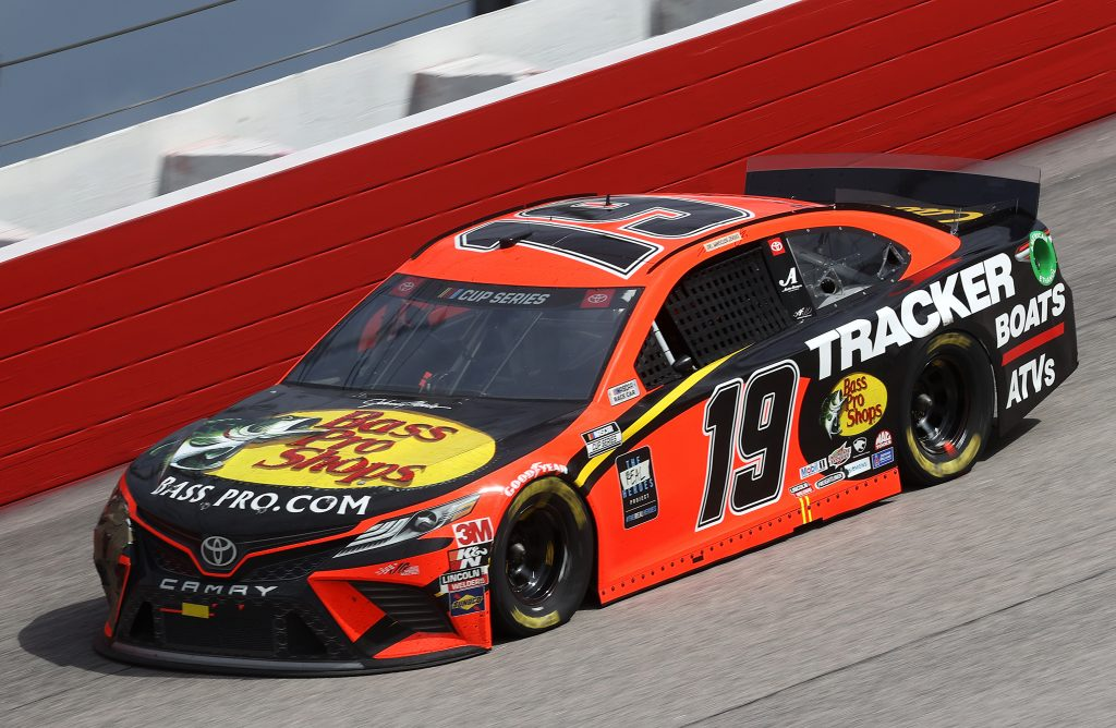 DARLINGTON, SOUTH CAROLINA - MAY 17: Martin Truex Jr., driver of the #19 Bass Pro Shops Toyota, drives during the NASCAR Cup Series The Real Heroes 400 at Darlington Raceway on May 17, 2020 in Darlington, South Carolina. NASCAR resumes the season after the nationwide lockdown due to the ongoing coronavirus (COVID-19). (Photo by Chris Graythen/Getty Images) | Getty Images