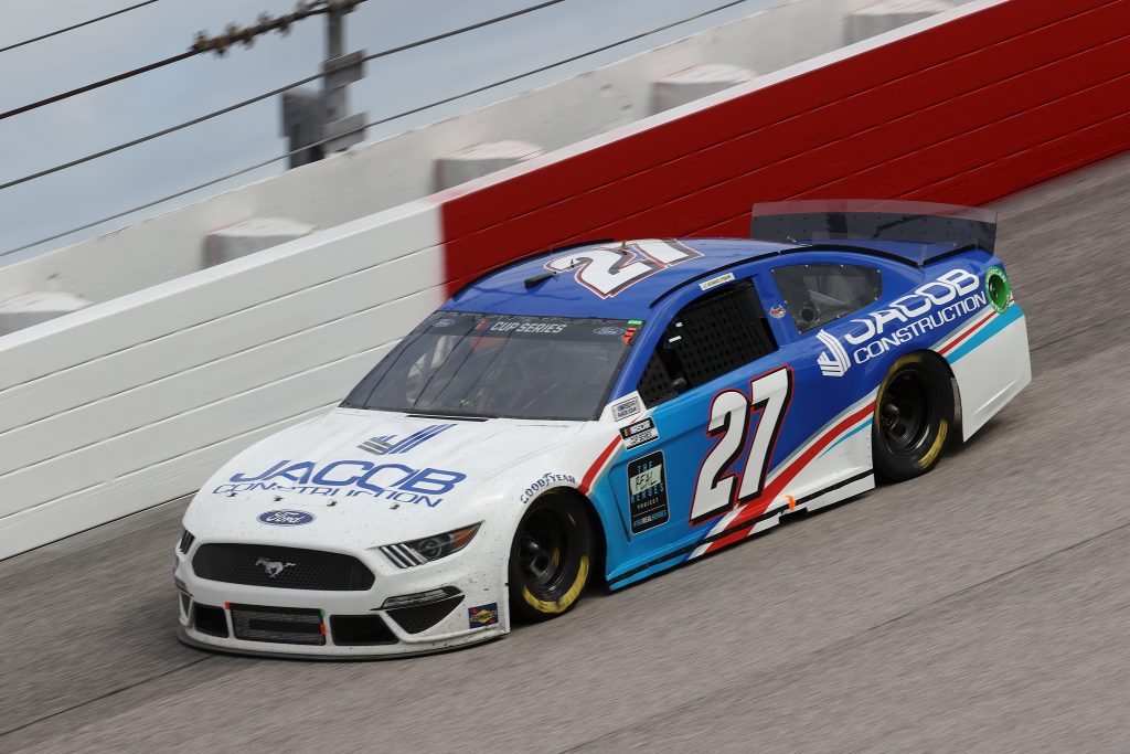 DARLINGTON, SOUTH CAROLINA - MAY 17: JJ Yeley, driver of the #27 Jacob Construction Ford, drives during the NASCAR Cup Series The Real Heroes 400 at Darlington Raceway on May 17, 2020 in Darlington, South Carolina. NASCAR resumes the season after the nationwide lockdown due to the ongoing coronavirus (COVID-19). (Photo by Chris Graythen/Getty Images) | Getty Images