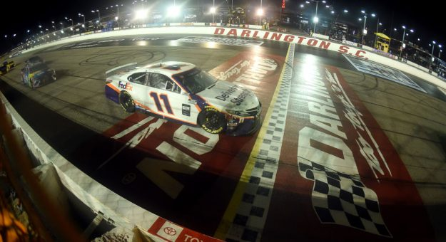 DARLINGTON, SOUTH CAROLINA - MAY 20: Denny Hamlin, driver of the #11 FedEx Delivering Strength Toyota, crosses the finish line under caution to later win the rain-delayed NASCAR Cup Series Toyota 500 at Darlington Raceway on May 20, 2020 in Darlington, South Carolina. (Photo by Jared C. Tilton/Getty Images) | Getty Images