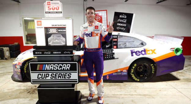 DARLINGTON, SOUTH CAROLINA - MAY 20: Denny Hamlin, driver of the #11 FedEx Delivering Strength Toyota, celebrates in Victory Lane after winning the rain-shortened NASCAR Cup Series Toyota 500 at Darlington Raceway on May 20, 2020 in Darlington, South Carolina. (Photo by Chris Graythen/Getty Images)   Getty Images