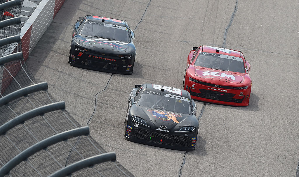 DARLINGTON, SOUTH CAROLINA - MAY 21: Colin Garrett, driver of the #26 Rosie Network Toyota, leads Jesse Little, driver of the #4 TeamJDMotorsports.com Chevrolet, and Matt Mills, driver of the #5 J F Electric Chevrolet,  during the NASCAR Xfinity Series Toyota 200 at Darlington Raceway on May 21, 2020 in Darlington, South Carolina. (Photo by Jared C. Tilton/Getty Images) | Getty Images