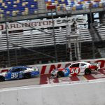 DARLINGTON, SOUTH CAROLINA - MAY 21: Chase Briscoe, driver of the #98 HighPoint.com Ford, crosses the finish line in front of Kyle Busch, driver of the #54 Thank You Heroes/M&M's Toyota, winning the NASCAR Xfinity Series Toyota 200 at Darlington Raceway on May 21, 2020 in Darlington, South Carolina. (Photo by Chris Graythen/Getty Images) | Getty Images