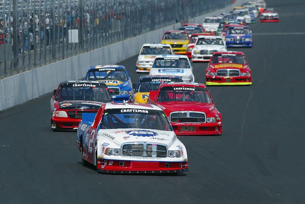 LOUDON, NH - JULY 20: Jason Leffler leads a pack of trucks in his #2 Carquest Racing Dodge Ram during the NASCAR Craftsman Truck Series Series New England 200 on July 20, 2002 at the New Hampshire International Speedway, in Loudon, New Hampshire. (Photo by Robert Laberge/Getty Images)