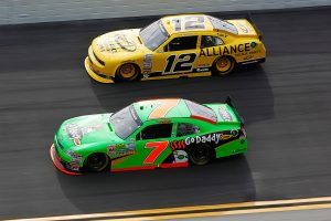 DAYTONA BEACH, FL – FEBRUARY 25: Danica Patrick, driver of the #7 GoDaddy.com Chevrolet, and Sam Hornish Jr., driver of the #12 Alliance Truck Parts Dodge, race during the NASCAR Nationwide Series DRIVE4COPD 300 at Daytona International Speedway on February 25, 2012 in Daytona Beach, Florida. (Photo by Streeter Lecka/Getty Images) | Getty Images
