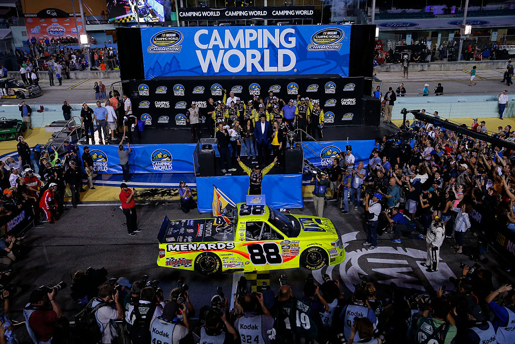 HOMESTEAD, FL - NOVEMBER 14: Matt Crafton, driver of the #88 Jeld-Wen/Menards Toyota celebrates in victory lane after winning during the NASCAR Camping World Truck Series Ford EcoBoost 200 at Homestead-Miami Speedway on November 14, 2014 in Homestead, Florida.