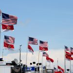 CHARLOTTE, NC - MAY 21:  Flags fly on top of haulers in the garage area during practice for the NASCAR Sprint Cup Series Coca-Cola 600 at Charlotte Motor Speedway on May 21, 2015 in Charlotte, North Carolina.  (Photo by Streeter Lecka/Getty Images)   Getty Images