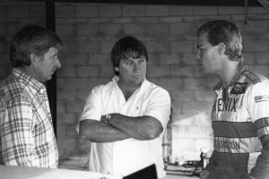 Unknown: Neil Bonnett (Left) talks with car owner James Finch (Center) and Finch's driver Jeff Purvis in the garage area at a NASCAR race. (Photo by ISC Images & Archives via Getty Images)
