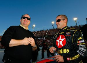 DARLINGTON, SC – MAY 13: Casey Mears (R), driver of the #42 Texaco Dodge talks with team owner Chip Ganassi before the NASCAR Nextel Cup Series Dodge Charger 500 on May 13, 2006 at Darlington Raceway in Darlington, South Carolina. (Photo by Rusty Jarrett/Getty Images for NASCAR)   Getty Images
