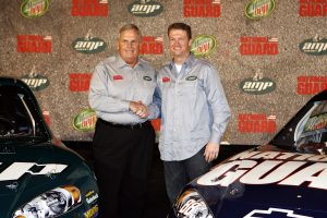 DALLAS, TX – SEPTEMBER 19: Dale Earnhardt Jr. (R) of the Hendrick Motorsports Racing Team poses with Rick Hendrick and his new cars on September 19, 2007 at the Dallas Convention Center in Dallas, Texas. (Photo by Layne Murdoch/Getty Images) | Getty Images