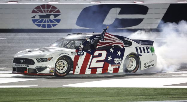 CONCORD, NORTH CAROLINA - MAY 24: Brad Keselowski, driver of the #2 Miller Lite Ford, celebrates after winning the NASCAR Cup Series Coca-Cola 600 at Charlotte Motor Speedway on May 24, 2020 in Concord, North Carolina. (Photo by Chris Graythen/Getty Images) | Getty Images