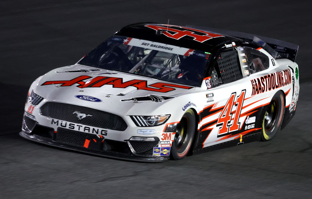 CONCORD, NORTH CAROLINA - MAY 24: Cole Custer, driver of the #41 HaasTooling.com Ford, leads a pack of cars during the NASCAR Cup Series Coca-Cola 600 at Charlotte Motor Speedway on May 24, 2020 in Concord, North Carolina. (Photo by Chris Graythen/Getty Images) | Getty Images