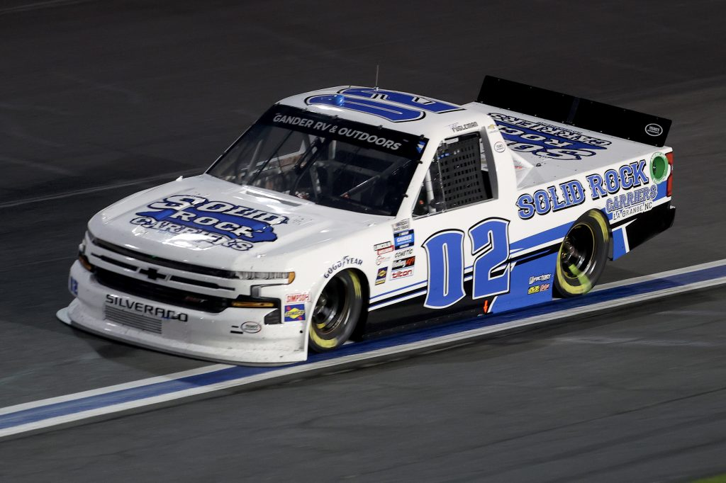 CONCORD, NORTH CAROLINA - MAY 26: Tate Fogleman, driver of the #02 Solid Rock Carriers Chevrolet, drives during the NASCAR Gander Outdoors Trucks Series North Carolina Education Lottery 200 at Charlotte Motor Speedway on May 26, 2020 in Concord, North Carolina. (Photo by Chris Graythen/Getty Images) | Getty Images