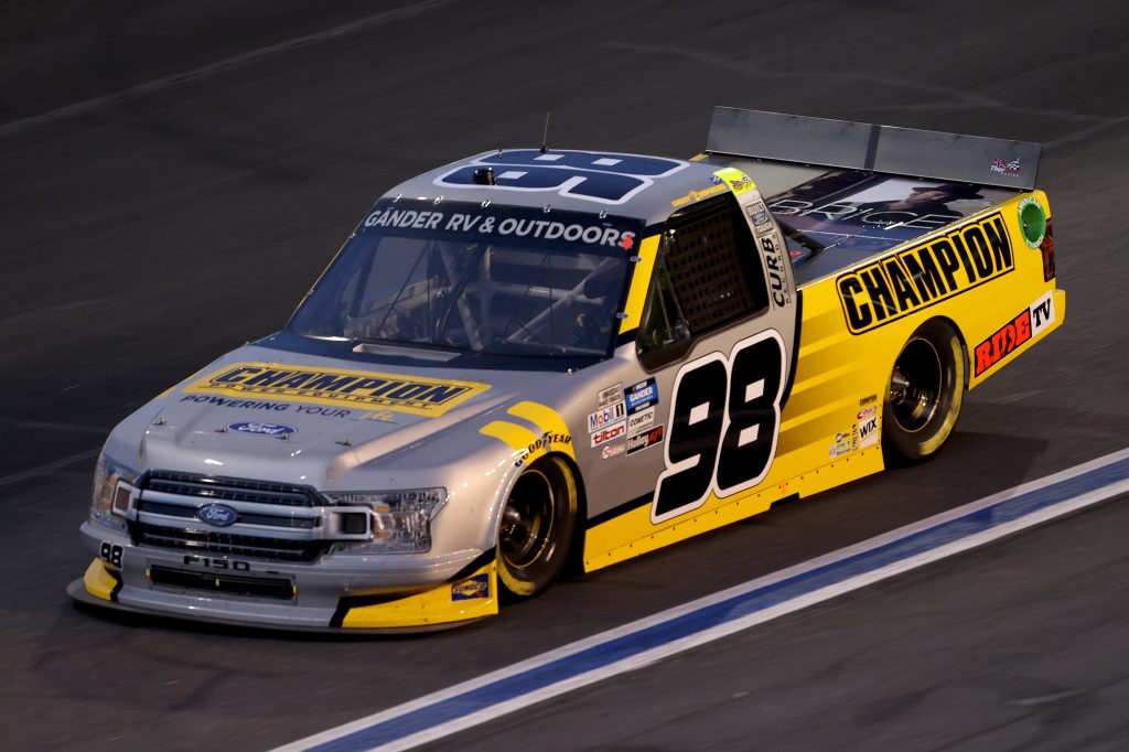 CONCORD, NORTH CAROLINA - MAY 26: Grant Enfinger, driver of the #98 Champion/Curb Records Ford, drives during the NASCAR Gander Outdoors Trucks Series North Carolina Education Lottery 200 at Charlotte Motor Speedway on May 26, 2020 in Concord, North Carolina. (Photo by Chris Graythen/Getty Images) | Getty Images
