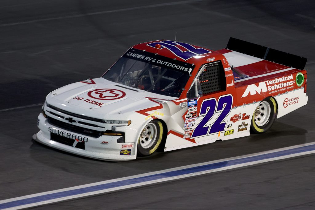 CONCORD, NORTH CAROLINA - MAY 26: Austin Wayne Self, driver of the #22 GO TEXAN/AM Technical Solutions Chevrolet, drives during the NASCAR Gander Outdoors Trucks Series North Carolina Education Lottery 200 at Charlotte Motor Speedway on May 26, 2020 in Concord, North Carolina. (Photo by Chris Graythen/Getty Images) | Getty Images