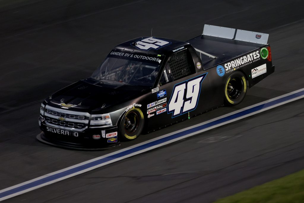 CONCORD, NORTH CAROLINA - MAY 26: Bayley Currey, driver of the #49 CMI Motorsports Chevrolet, drives during the NASCAR Gander Outdoors Trucks Series North Carolina Education Lottery 200 at Charlotte Motor Speedway on May 26, 2020 in Concord, North Carolina. (Photo by Chris Graythen/Getty Images) | Getty Images