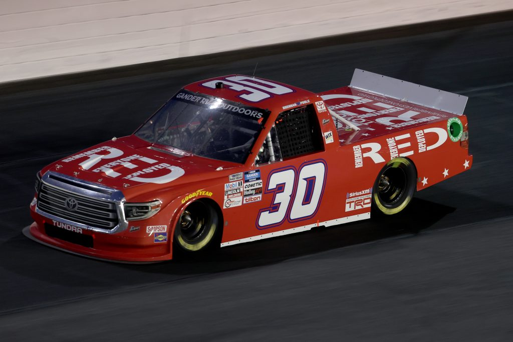 CONCORD, NORTH CAROLINA - MAY 26: Brennan Poole, driver of the #30 (RED) Remember Everyone Deployed Toyota, drives during the NASCAR Gander Outdoors Trucks Series North Carolina Education Lottery 200 at Charlotte Motor Speedway on May 26, 2020 in Concord, North Carolina. (Photo by Chris Graythen/Getty Images) | Getty Images