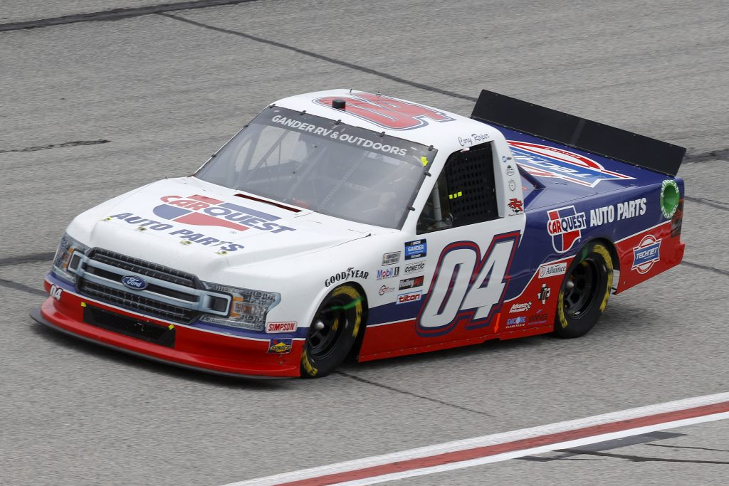 HAMPTON, GEORGIA - JUNE 06: Cory Roper, driver of the #04 CarQuest Ford, drives during the NASCAR Gander Outdoors Truck Series Vet Tix Camping World 200 at Atlanta Motor Speedway on June 06, 2020 in Hampton, Georgia. (Photo by Chris Graythen/Getty Images) | Getty Images