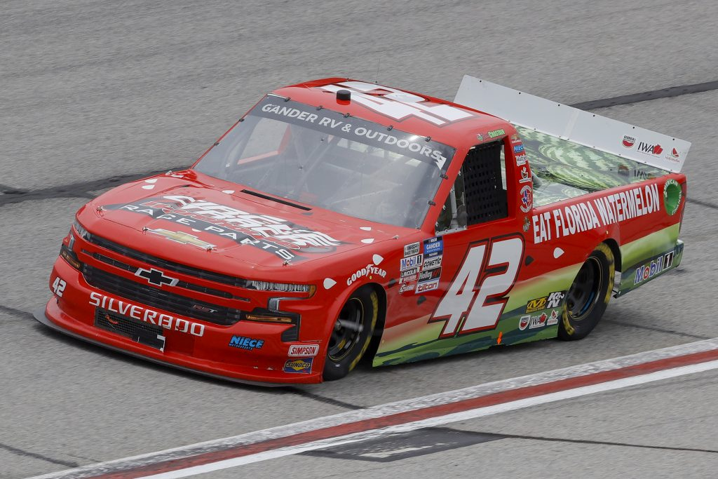 HAMPTON, GEORGIA - JUNE 06: Ross Chastain, driver of the #42 Florida Watermelon Association Chevrolet, drives during the NASCAR Gander Outdoors Truck Series Vet Tix Camping World 200 at Atlanta Motor Speedway on June 06, 2020 in Hampton, Georgia. (Photo by Chris Graythen/Getty Images) | Getty Images