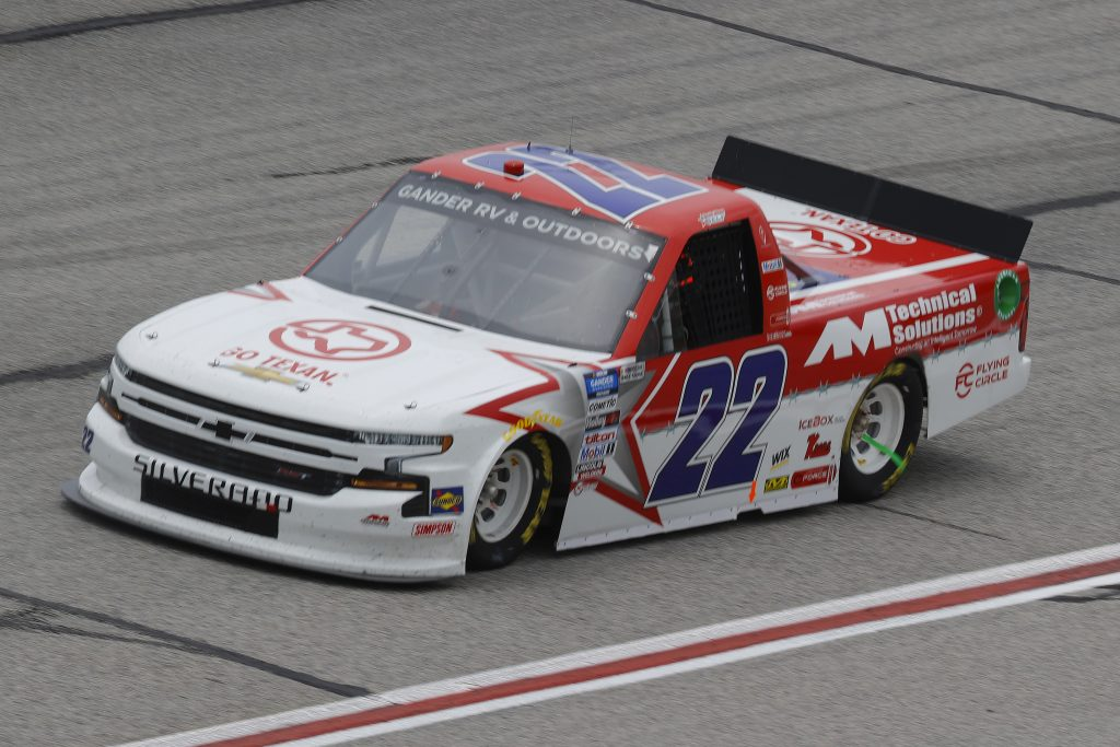 HAMPTON, GEORGIA - JUNE 06: Austin Wayne Self, driver of the #22 GO TEXAN/AM Technical Solutions Chevrolet, drives during the NASCAR Gander Outdoors Truck Series Vet Tix Camping World 200 at Atlanta Motor Speedway on June 06, 2020 in Hampton, Georgia. (Photo by Chris Graythen/Getty Images) | Getty Images