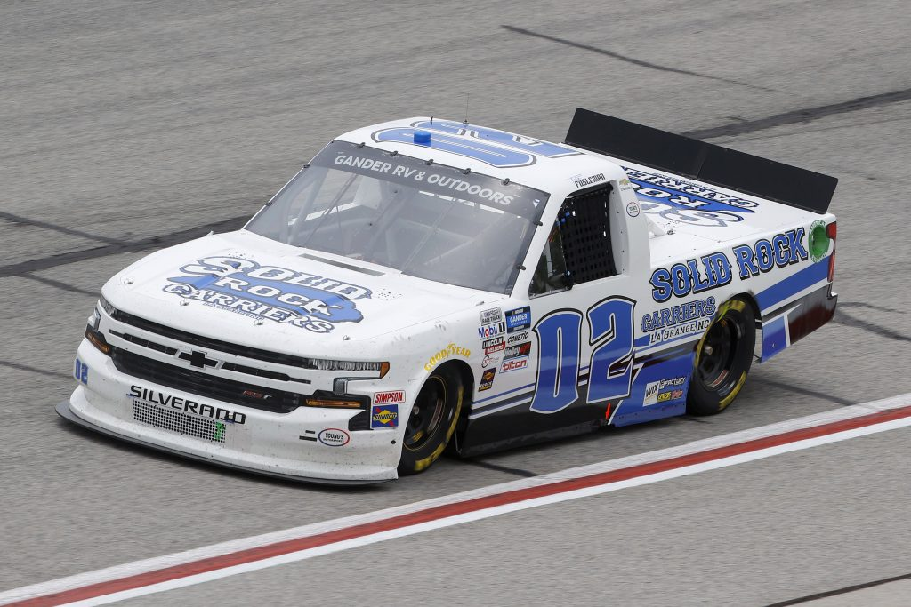 HAMPTON, GEORGIA - JUNE 06: Tate Fogleman, driver of the #02 Solid Rock Carriers Chevrolet, drives during the NASCAR Gander Outdoors Truck Series Vet Tix Camping World 200 at Atlanta Motor Speedway on June 06, 2020 in Hampton, Georgia. (Photo by Chris Graythen/Getty Images) | Getty Images