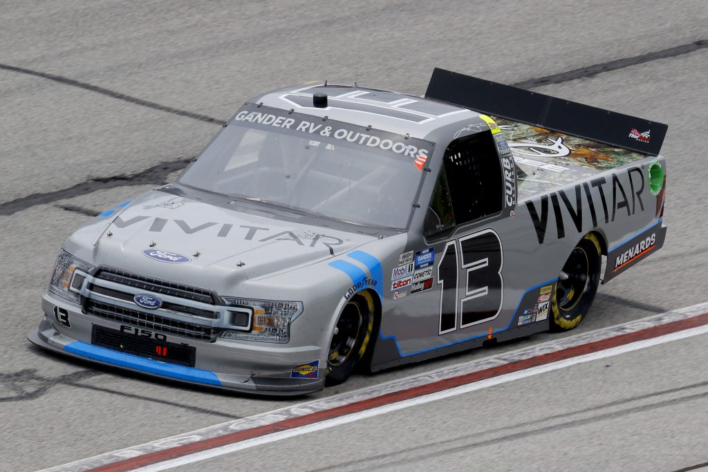 HAMPTON, GEORGIA - JUNE 06: Johnny Sauter, driver of the #13 Vivitar/Altec Lansing Ford, drives during the NASCAR Gander Outdoors Truck Series Vet Tix Camping World 200 at Atlanta Motor Speedway on June 06, 2020 in Hampton, Georgia. (Photo by Chris Graythen/Getty Images) | Getty Images