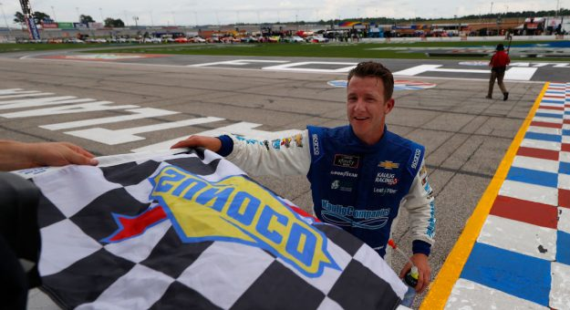 HAMPTON, GEORGIA - JUNE 06: AJ Allmendinger, driver of the #16 C2 Freight Resources Chevrolet, takes the checkered flag after winning the NASCAR Xfinity Series EchoPark 250 at Atlanta Motor Speedway on June 06, 2020 in Hampton, Georgia. (Photo by Kevin C. Cox/Getty Images) | Getty Images